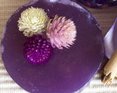Purple soap with flowers — Stock Photo