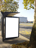 City light on the bus stop, blank space for your ad — Stock Photo