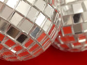 Decorative disco balls on the red background — Stock Photo
