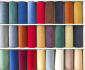 Colorful carpets samples on the shelves — Stock Photo