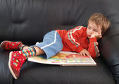 Boy lies on bad. It's a boring day — Stock Photo
