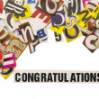 Royalty-Free Stock Photo: Word congratulation with cut letters