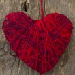 Red heart on the wooden background - Stock Photo