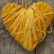 Yellow heart on the wooden background - Stock Photo