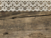 Lace on the wooden background — Stock Photo