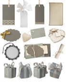 Collection of gray tags and gift boxes — Stock Photo