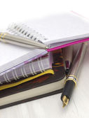 Notebooks and pen, office arrangement — Stock Photo