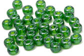 Green beads isolated on white background — Stock Photo
