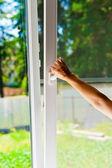 Plastic windows with mosquito nets — Stock Photo