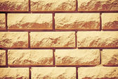 Background from the ragged brick — Stock Photo