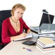 Attractive businesswoman working at busy desk — Foto Stock