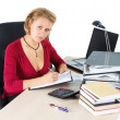 Attractive businesswoman working at busy desk — Stok fotoğraf