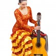 Flamenco dancer sitting on old suitcase with a guitar — Stock Photo #11235934