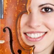 Female face with violin — Stock Photo