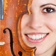 Female face with violin — Stock Photo #11235953