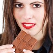 Stock Photo: Beautiful woman eating chocolate