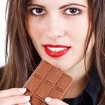 Beautiful woman eating chocolate — Stock Photo