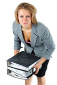Young businesswoman lifting notepads — Stock Photo