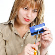 Young woman destroying credit card — Stock Photo