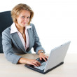 Businesswoman with laptop smiling into camera — Stock Photo #11269206