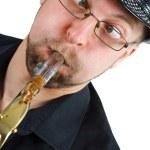 grimas met saxofoon — Stockfoto