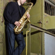 Saxophone player outdoors — Stock Photo