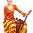 Flamenco dancer sitting on old suitcase with a guitar — Stock Photo