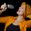 Young woman funky singer over black background — Stock Photo