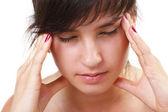 Beautiful young woman has a headache — Stock Photo