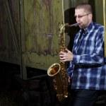 Saxophone player outdoors — Stock Photo
