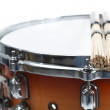 Unplugged drumsticks resting on a snare drum — Stock Photo #11375997