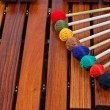 Coloured mallets on marimba - Stock Photo