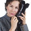 Attractive young woman holding a camera — Stock Photo #11376020