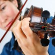 Young woman playing the violin — Foto Stock