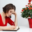 Young woman at home writing — Stock Photo #11376069