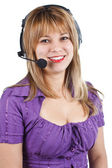 Young woman with headset — Stock Photo