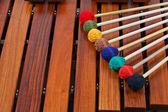Coloured mallets on marimba — Stock Photo