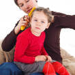 Mother combing daughter&amp;#039;s hair - Stock Photo