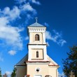 Village church with blue sky — Stock Photo