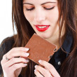 Beautiful woman eating chocolate — Stock Photo