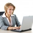Businesswoman looking at her laptop — Stock Photo #11400267