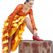 Flamenco dancer putting on red shoe on suitcase — Stock Photo #11400284