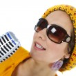 Portrait of female funky singer with microphone in hand — Stock Photo