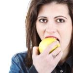 Beautiful woman eating apple — Stock Photo