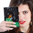 Beautiful woman with hard disc - Stok fotoğraf
