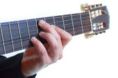 Male fingers playing the guitar — Stock Photo