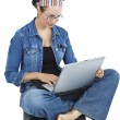 Attractive young woman sitting with a computer in her lap — Stock Photo #11446624