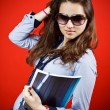 Teenage girl with notes and sunglasses — Stock Photo