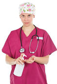 Female doctor with liquid soap — Stock Photo