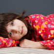 Cute girl in pyjamas - Stock Photo